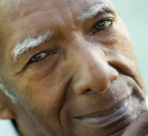 elderly man staring into camera