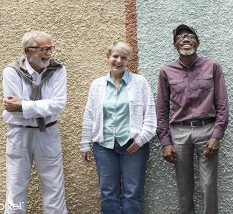elderly people laughing against wall