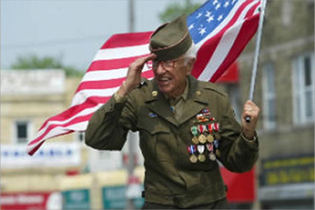 Veteran Holding Flag