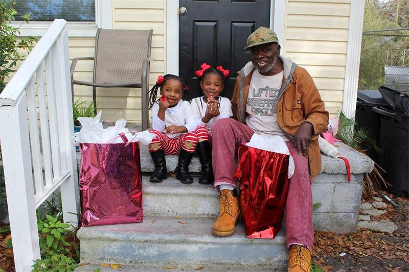 Man and Children sat on step